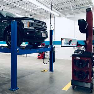 Car lift inside Matrix Trade Institute auto tech school.